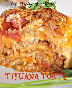 Tijuana Torte uses ground beef with stewed tomatoes, diced green chilies, taco seasoning--layered with flour tortillas, cheddar cheese, and sour cream.