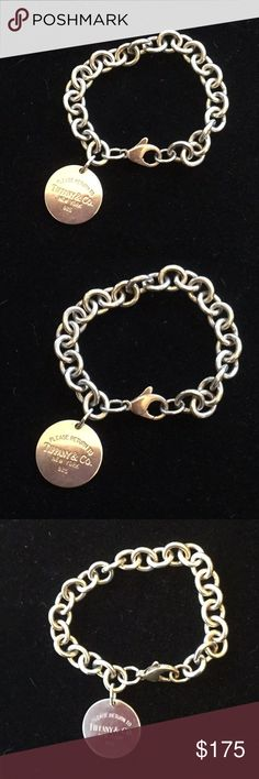 Genuine Tiffany Round Charm Bracelet Here it is genuine Tiffany at a great price.  This is a piece you can wear and it says style,  class and cash !  A classic bracelet that features the Return to Tiffany's logo on a  Sterling Chain. Tiffany & Co. Jewelry Bracelets