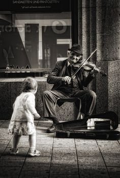 Street musician performs while a child dances. Black and white… Sponsored Sponsored ZsaZsa Bellagio. Street musician performs while a child dances. Black and white photograph. Black White Photos, Black And White Photography, Life Photography, Vintage Photography, Photography Ideas, People Photography, Landscape Photography, Photography Colleges, Flower Photography