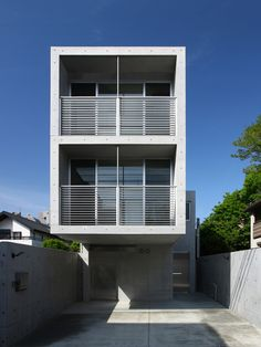 Japanese firm atelier HAKO architects used concrete dotted with formwork impressions for both the internal and external surfaces of these stacked residences in a suburb of Tokyo.