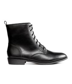 Check this out! Ankle boots in imitation leather with a loop at back and lacing at front. Fabric lining, fabric insoles, and rubber soles. Heel height 1 in. - Visit hm.com to see more.