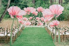 Unbelievably beautiful ceremony decor! Giant painted flowers. So dreamy and whimsical. I'm in love.