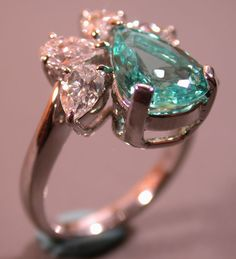 Paraiba tourmaline and diamond.  Gorgeous color!
