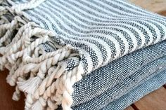 """Turkish Peshtemal Towels - are used as """"an expression of hospitality,"""" known to be highly absorbent, lightweight and fast-drying and super cute with tassels at the end"""