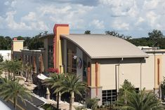 The curved metal roof atop Celebration Pointe 10 in Gainesville, Florida was a challenging, but rewarding, installation for the roofing crew. The roof uses 6,200 sq. ft. of PAC-CLAD panels coated in Sierra Tan for a natural color palette.  Architect: RLS Design Group Metal Panels: Petersen Aluminum #metalroof #curvedroof #metalpanels #colorpalette #coilcoatings Gainesville Florida, Nature Color Palette, Metal Panels, Metal Roof, Celebration, Group, Natural, Outdoor Decor, Design