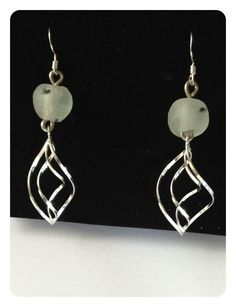 These Stunning Sterling silver drop earrings are made with white recycled glass beads with a hint of black from Ghana.
