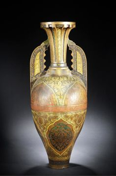 A large Hispano-Moresque pottery Jar   Granada, late 19th Century  decorated in gilt and polychrome, the pear-shaped body with sloping shoulders attached to the neck by a pair of flattened handles, the lower half of the body with lobed medallions containing arabesque interlace, the upper part with half-medallions filled with inscriptions, the handles with calligraphic borders   145 cm. high