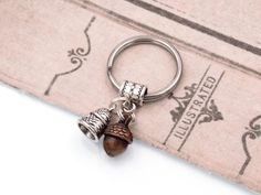 Peter Pan Kiss Keychain with Acorn & Thimble Charms by fripparie from fripparie. Visit http://ift.tt/1o0ATec for more awesome steampunk fantasy and goth jewelry and accessories.