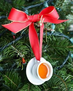 """Love these DIY resin """"tea cup"""" ornaments - the perfect handmade gift for tea lovers, plus a great way to re-use a thrifted child's tea set!"""