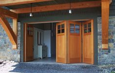 Folding doors allow wide access to boats and more for the lake house. D8