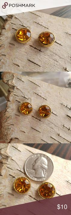 Vintage citrine glass stud earrings studs Beautiful vtg pair of earrings - sparkly orangey yellow citrine glass set in gold tone metal - in good condition with some age wear, greenish tarnish in spots but clean and wear is not noticible when worn - true vintage made about 1970s - from a smoke free home Vintage Jewelry Earrings