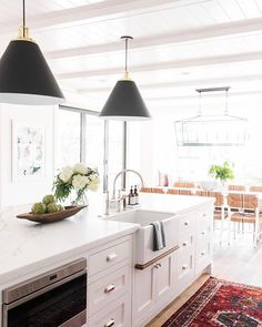 There's just so much to love about this space!! This week we've been talking about Cone Pendant Lighting We love the statement they make over an island! These are the black version of the ones we used in our #chanhassenproject :b