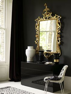 Beautiful mirror on black wall..or prehaps a dark green or wine red wall