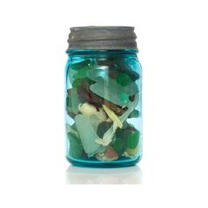 Sea Glass, Beach Glass, Tumbled Glass: What's the Difference? ❤ liked on Polyvore featuring home, home decor, fillers, glass home decor and sea glass home decor