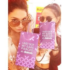 Vanessa Hudgens and sister Stella Hudgens dropped by Claire's to get their ears pierced!