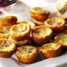 When I need a festive finger food, this quiche recipe's the one I reach for. With cheese in both the... - Provided by Taste of Home