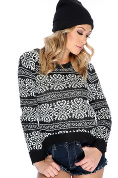 Wear this perfect Holiday sweater out for season! Features; round neckline, long sleeve, holiday print, two tone, knit, high-low hem and followed by a pull over comfy fit. 100% Acrylic
