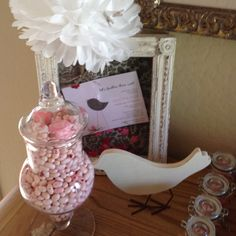 Shadow box with baby shower invite; candy jar and candy jar favors