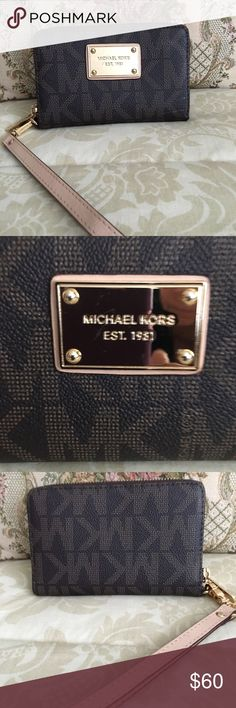 SALE Michael Kors Jet Set Wallet/Wristlet Saffiano leather Michael Kors signature monogram wallet/wristlet/phone case. Gold-tone hardware. Zip around with logo pull tab; detachable leather wristlet strap; Michael Kors name plaque. Three interior credit card slots; middle phone compartment; side pocket & 2 additional open pockets. Like new condition. Michael Kors Bags Clutches & Wristlets