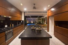 This mostly wood kitchen with black countertops opens up to a courtyard with small swimming pool. FGO/Arquitectura have designed this single level house in Merida, Mexico, that makes the most of it's indoor/outdoor design. Black Kitchen Countertops, New Modern House, Contemporary Interior Design, Contemporary Homes, Interior Modern, Outdoor Kitchen Design, Indoor Outdoor Living, Interior Exterior, New Kitchen