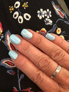 Light Blue Gel with white leaf accent nail