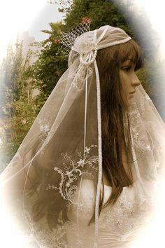 "Vintage Juliet Veil, Bridal Cap Veil, ""Abby"" Pearls and Lace Flowers,  by LasVegasVeils on Etsy, £117.09"
