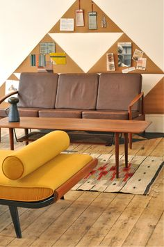 Brown leather sofa with stained beech legs by Danish furniture makers Stouby; coffee table with waterfall edges designed by Danish duo Hvidt / Molgaard-Nielsen for France & Sons; Cordemeijer daybed for Auping