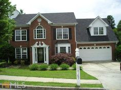 Brick front family home in desirable school district in Buford Georgia.