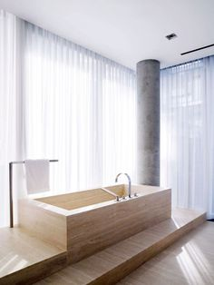 pale honey toned stone bathroom by  architects Yabu Pushelberg.