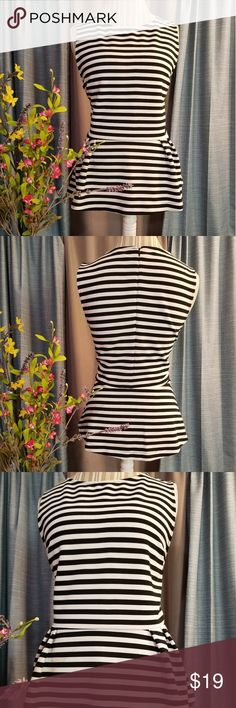 🌻🌺🌻ATTENTION PEPLUM BLOUSE!! SIZE: LARGE   BRAND: ATTENTION   CONDITION: LIKE NEW   COLOR: WHITE/BLACK  HAS ZIPPER IN BACK   🌟POSH AMBASSADOR, BUY WITH CONFIDENCE!   🌟CHECK OUT MY OTHER ITEMS TO BUNDLE AND SAVE ON SHIPPING!   🌟OFFERS WELCOME!   🌟FAST SHIPPING! attention Tops