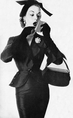 Adele Simpson suit, Bag by Coblentz,  Hat by Lilly Dache, Diamond-flowered pearl pin and earrings by Schlumberger, modeled by Jean Patchett.
