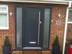 Image result for contemporary composite front doors with side panels