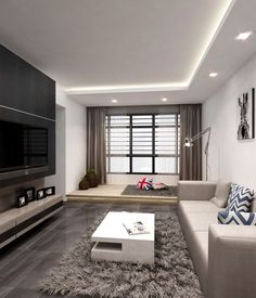 The living area features many gems, like the platform that distinguishes as a separate room. Or the TV feature wall, which is as dramatic as possible, with hidden storage in it. Or in the dining area, the mirror that reflects the whole table. The living area of the apartment has everything, but the main theme and the primary focus is hidden in a subtle way. In its essence, the interior style used is a modern one, with emphasize on texture to add depth, character and style in it. We see…