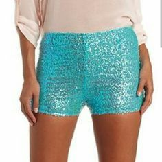 Tiffany blue sequin shorts Gorgeous Medium sized sequin shorts Dazzling Tiffany blue color  from Charlotte russe Very stretchy 100%polyester Zipper on back Charlotte Russe Shorts