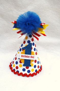 Little Dude birthday party hat in red yellow and blue polka dot primary colors on Etsy, $14.50