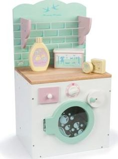 Le Toy Van Washing machine `One size Drawer to add washing product, Manual command that rotates and control button Details : 1 washing machine, 1 clothes horse, 1 soap(s), 1 soap box, 1 softener Age : From 3 years old Fabrics : Wood 34.4 http://www.comparestoreprices.co.uk/january-2017-7/le-toy-van-washing-machine-one-size.asp