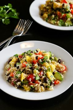 This black bean and mango quinoa salad is a healthy vegetarian side dish or main course that's bursting with fresh flavour!  It is also gluten free and easily adapted to be vegan.
