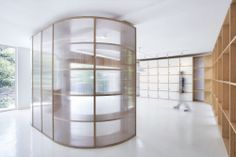 Semi-translucent polycarbonate panels and wooden shelving systems create partitions in this office renovation for a television station in Hangzhou, China, by Daipu Architects (+ slideshow). Hangzhou, Create Partition, Wood Partition, Interior Walls, Best Interior, Interior Design, Polycarbonate Panels, Curved Walls, Plastic Design
