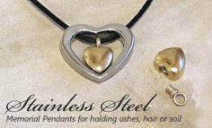 """Stainless Steel and Gold """"Your Heart In Mine"""" memorial pendant."""
