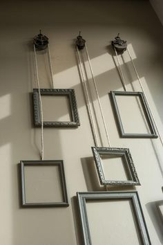 Hanging frames attached to a pulley system tie the upstairs and downstairs living spaces together. : Hanging frames attached to a pulley system tie the upstairs and downstairs living spaces together. Decoration Vitrine, Frame Decoration, Vintage Industrial Decor, Industrial Style, Antique Wall Decor, Industrial Wall Art, Industrial Furniture, Industrial Design, Hanging Frames