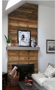 Almost finished with my pallet wood fireplace makeover! Más The post Almost finished with my pallet wood fireplace makeover! Pallet Fireplace, Wooden Fireplace Surround, Reclaimed Wood Fireplace, Fireplace Redo, Faux Fireplace, Fireplace Remodel, Fireplace Surrounds, Fireplace Design, Pallet Wood