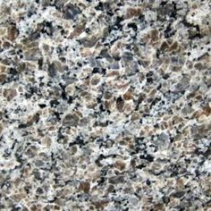SILVER BROWN. Clusters of silver and brown with black on a creamy white. Gorgeous granite color available at Knoxville's Stone Interiors. Showroom located at 3900 Middlebrook Pike, Knoxville, TN. www.knoxstoneinteriors.com. FREE Estimates available, call 865-971-5800.