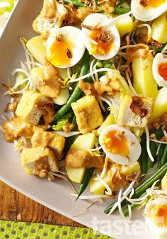 Gado gado, a vegetable salad served with peanut sauce and boiled eggs, is a classic Indonesian dish. We have added tofu puffs for an extra twist. (Recipe by Jessica Brook; Photography by Brett Stevens)