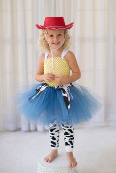 This Cowgirl / Toy Story Inspired Jessie tutu dress / costume is sure to bring a big smile and a lot of fun and wonder to your little girl! Whether your little girl loves Jessie or is just a sweet lit