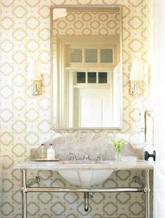 Courtney Hill Interiors: Chic powder room design with gray geometric wallpaper, marble washstand, pewter ...
