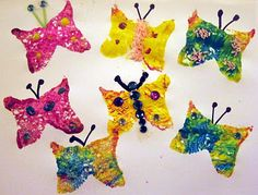 "Beautiful Textured Butterflies craft for toddler and preschool children inspired by Eric Carle's ""Very Hungry Caterpillar. Make them will sponges and paint!"