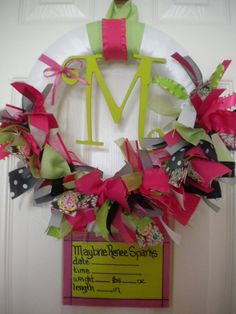 baby girl ribbon wreath with birth announcement for hospital door in pinks and greens