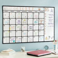 Dry-erase calendar art is a great DIY dorm room decor idea!