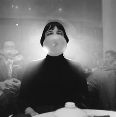 Fellig, Arthur (Weegee)(1899-1968) - 1940 A woman in a nightclub goes cross-eyed as her bubblegum bubble expands in front of her face | by RasMarley