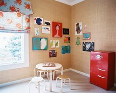 Kids' Room - Grass-cloth wallpaper hung with children's art in a playroom